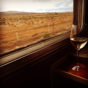 Luxury Train Travel: Enjoying a wine on epic train ride