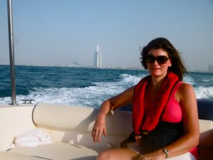 Cool shot of SassyZenGirl Gundi Gabrielle on a luxury yacht with Burj A Arab in the background